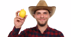 Optimistic Gardener Farmer Man Looking Camera and Holding Delicious Yellow Lemon Stock Footage
