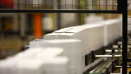 Cardboard boxes on a conveyor belt of a production line. Stock Footage
