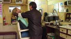 Man getting straight razor shave in barber shop ecuador Stock Footage
