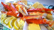 Red king crab legs with fresh lemon slices Stock Footage
