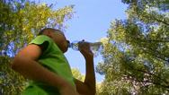 Boy drinks water from a plastic bottle Stock Footage
