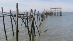 Old wooden fishing port with low tide carrasqueira portugal slowmotion120fps Stock Footage
