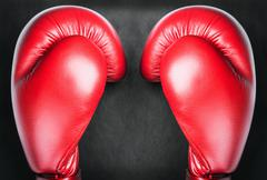 Red leather boxing gloves Stock Photos