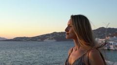 Beautiful blonde model staring into sunset mykonos greece slow motion Stock Footage