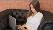 Young attractive businesswoman working on modern laptop Stock Footage