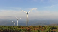 Eolic windmill turbine wind renewable energy farm on top of mountain slowmotion Stock Footage