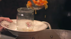 Woman puts hot cooked vegetables in jar for canning Stock Footage