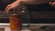 Woman preserves vegetables using seaming key Stock Footage