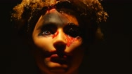 4K Creepy Doll Face With Dramatic Light Passing Over Stock Footage