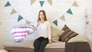 Girl with balloon on birthday smiles for the camera Stock Footage