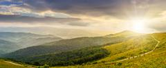Hillside panorama in mountains at sunset Stock Photos