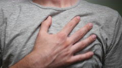 4K Heart Chest Pain Man Hand Rubbing Stock Footage