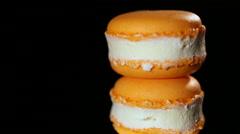 Appetizing baked dessert, sweet orange macaron close-up, confectionery art Stock Footage