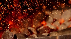 Sparks from coals in slow motion Stock Footage