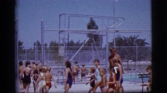 1968: a crowd files into a local swimming pool COTTONWOOD, ARIZONA Stock Footage