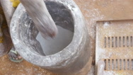 African woman grinds the flour in the mortar slow motion Stock Footage