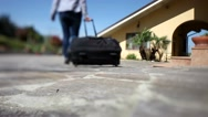 Young woman leaving her home with luggage. Close up. Stock Footage