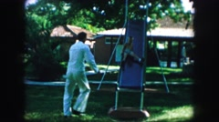 1958: in the park with the kids and family to strengthen ties and feeling. AMES Stock Footage