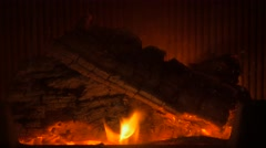 Wood logs burning on fire place with sparkles 4K 2160p 30fps UHD footage - Cl Stock Footage