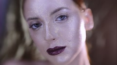 Beautyful girl with gold glitter on her face Stock Footage