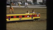 1958: two children riding in a small train ride at a fair. AMES, IOWA Stock Footage
