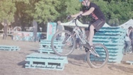 Cyclist doing jump MTB tricks in bicycle HD speed video. Mountain bike trial Stock Footage