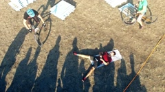 Cyclists jump over man bicycle aerial HD video. MTB tricks Mountain bike trial Stock Footage