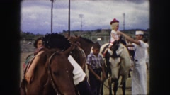 1958: a horse is seen with a rider AMES, IOWA Stock Footage