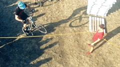 Cyclists doing tricks jumping over obstacle in MTB bicycle HD aerial video Stock Footage