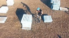 Cyclist doing jump MTB tricks in bicycle HD aerial video. Mountain bike trial Stock Footage