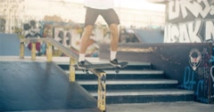 Skateboarder on skate doing rail slide grind tricks HD video on skateboard park Stock Footage