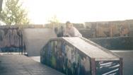 Skateboarder on skate doing jump tricks HD slow motion video on skateboard park Stock Footage