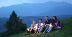 Cheerful Friends Lighting Sparklers Group Singing Christmas Celebration Mountain Stock Footage