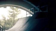 Skateboarder on skate doing tricks HD video slow motion on ramp skateboard park Stock Footage