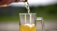 Locked down shot of pouring frozen beer inside a beer mug. Stock Footage