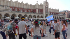 Krakow WYD 2016 - Teenagers playing, dancing in circle, cowded main square  Stock Footage