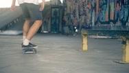 Skateboarder on skate doing jump tricks HD video on skateboard park Stock Footage