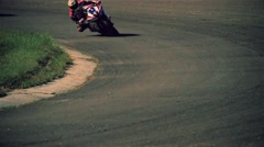 Motorcycle rider in turn on circuit road track racing HD slow motion video Stock Footage