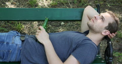 Sad Young Boy Sitting on Park Bench Man Having Drink Problem Alcohol Addiction Stock Footage