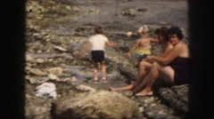 1958: spending a hot and sunny summer day together at the nearby river. AMES Stock Footage