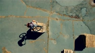 Cyclist doing jump MTB tricks in bicycle 4k aerial video Mountain bike trial Stock Footage