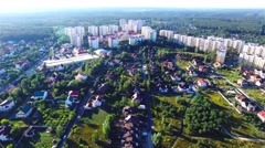 Flying over city village 4k aerial video housing real estate urban landscape Stock Footage