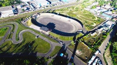 Flying over road racing track stadium 4k aerial video. Races circuit motocross Stock Footage
