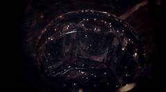 Pile falling in wineglass in slow motion Stock Footage
