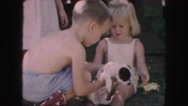 1958: children are seen having fun in a garden area AMES, IOWA Stock Footage