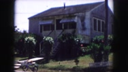 1958: a bicycle parked on the sidewalk in front of a house AMES, IOWA Stock Footage