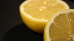 Juicy cut lemon rich in vitamin C, effective remedy and antiseptic in medicine Stock Footage