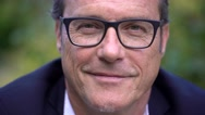 Portrait of a mature, attractive business man with black glasses. Stock Footage