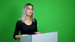 Businesswoman making a presentation at green screen background Stock Footage