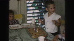 1958: gathered around a table for some cake at someone's party AMES, IOWA Stock Footage